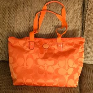 Coach bright orange weekender/tote